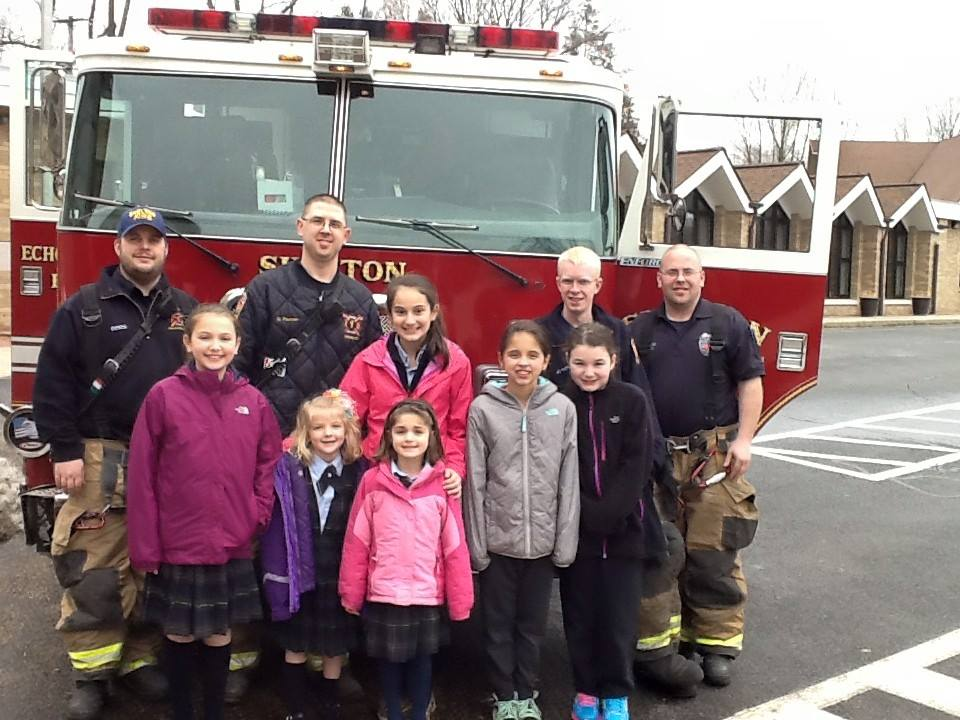 Members of the Echo Hose Hook and Ladder were at St. Lawrence School today having lunch with 6 students who won an auction prize for a fundraiser that benefited their school.  Photo courtesy of Principal Hamilton